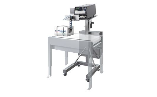 Scanvaegt SVA90 label printer with the applicator is mounted at a 90 degree angle to the conveyor belt.